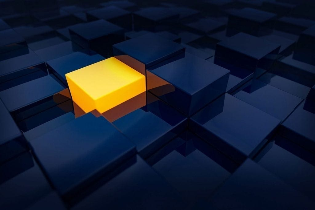 Orange cube amongst blue cubes